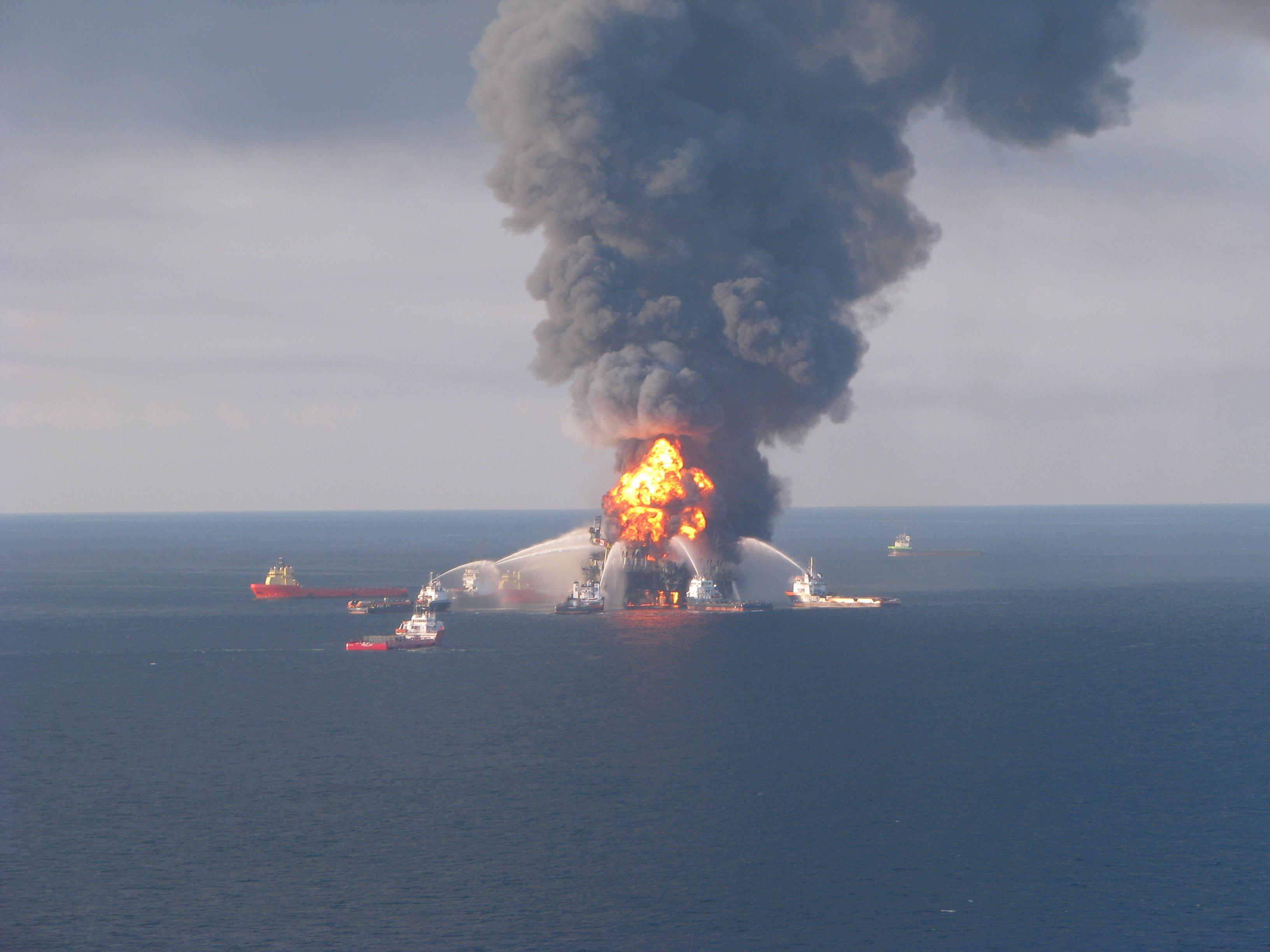 Fire fighting ships surround the burning Deepwater Horizon oil rig, shooting water at it to put out the flames.<div class='credit'><strong>Credit:</strong> Fire fighting ships surround the burning Deepwater Horizon oil rig, shooting water at it to put out the flames.</div>