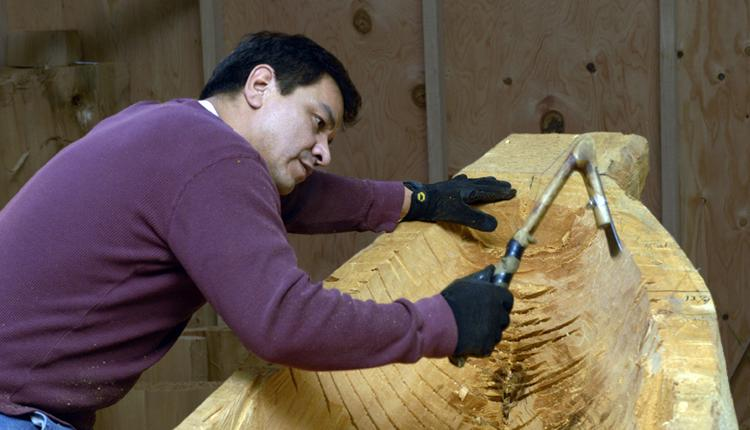 Douglas Chilton uses traditional carving tools to shape the Raven Spirit canoe.<div class='credit'><strong>Credit:</strong> Douglas Chilton uses traditional carving tools to shape the Raven Spirit canoe.</div>