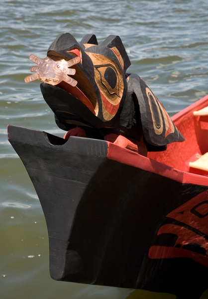 With the sun in its beak, the canoe's raven figurehead points the way.<div class='credit'><strong>Credit:</strong> With the sun in its beak, the canoe's raven figurehead points the way.</div>