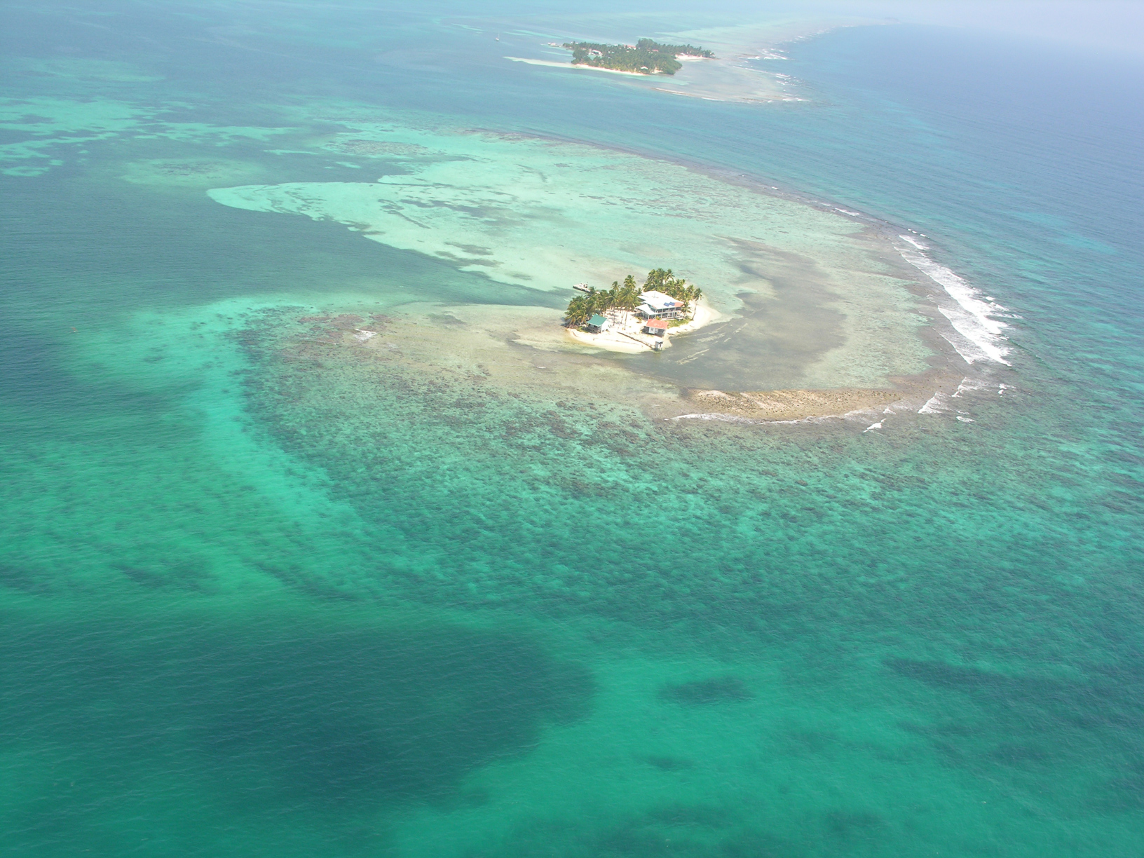 An aerial photo of Carrie Bow Cay and the Smithsonian research station looking north. <div class='credit'><strong>Credit:</strong> An aerial photo of Carrie Bow Cay and the Smithsonian research station looking north. </div>