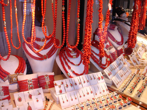 a display case of red coral jewelry containing necklaces, earrings, bracelets, and rings<div class='credit'><strong>Credit:</strong> a display case of red coral jewelry containing necklaces, earrings, bracelets, and rings</div>