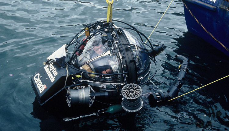 Dr. Clyde Roper prepares to dive thousands of feet to a giant squid habitat off the coast of New Zealand in a one-person submersible.<div class='credit'><strong>Credit:</strong> Dr. Clyde Roper prepares to dive thousands of feet to a giant squid habitat off the coast of New Zealand in a one-person submersible.</div>