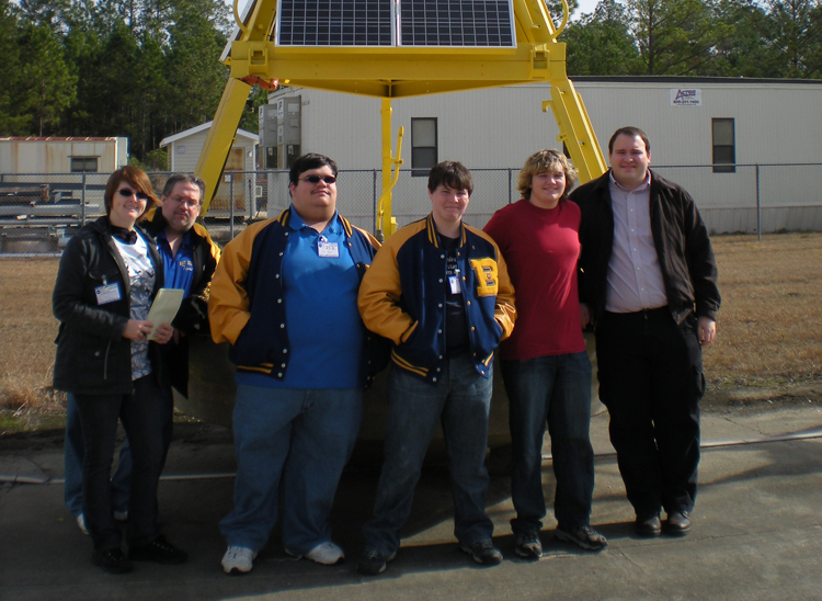 Students studying climate change pose for a photo at a NOAA facility.<div class='credit'><strong>Credit:</strong> Students studying climate change pose for a photo at a NOAA facility.</div>