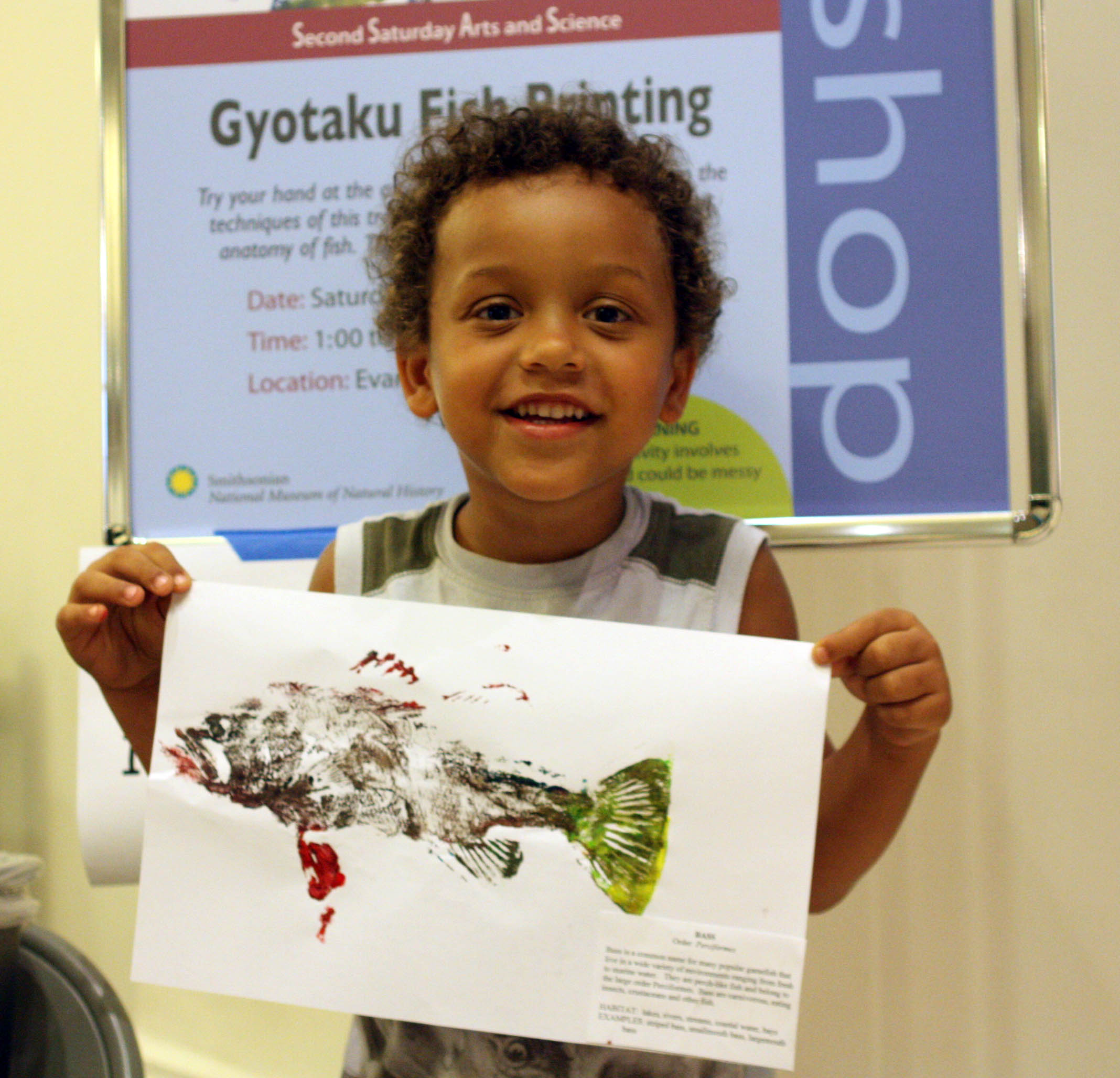 A young visitor holds up his painted fish Gyotaku fish print at the Smithsonian's National Museum of Natural History<div class='credit'><strong>Credit:</strong> A young visitor holds up his painted fish Gyotaku fish print at the Smithsonian's National Museum of Natural History</div>