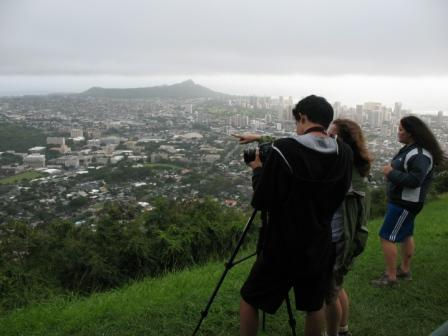 Students studying rainfall point their camera to the clouds.<div class='credit'><strong>Credit:</strong> Students studying rainfall point their camera to the clouds.</div>