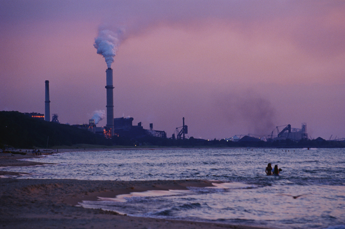 Swimmers brave the waters in the shadow of a coal-fired power plant.  Coal plants like this one emit CO2 into our atmosphere which is warming the planet and altering the chemistry of the ocean.<div class='credit'><strong>Credit:</strong> Swimmers brave the waters in the shadow of a coal-fired power plant.  Coal plants like this one emit CO2 into our atmosphere which is warming the planet and altering the chemistry of the ocean.</div>
