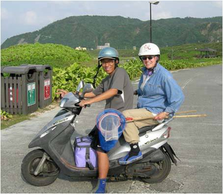 Curator and Research Scientist Lynne Parenti with student Shao-i Wang on a moped with fish collection gear<div class='credit'><strong>Credit:</strong> Curator and Research Scientist Lynne Parenti with student Shao-i Wang on a moped with fish collection gear</div>