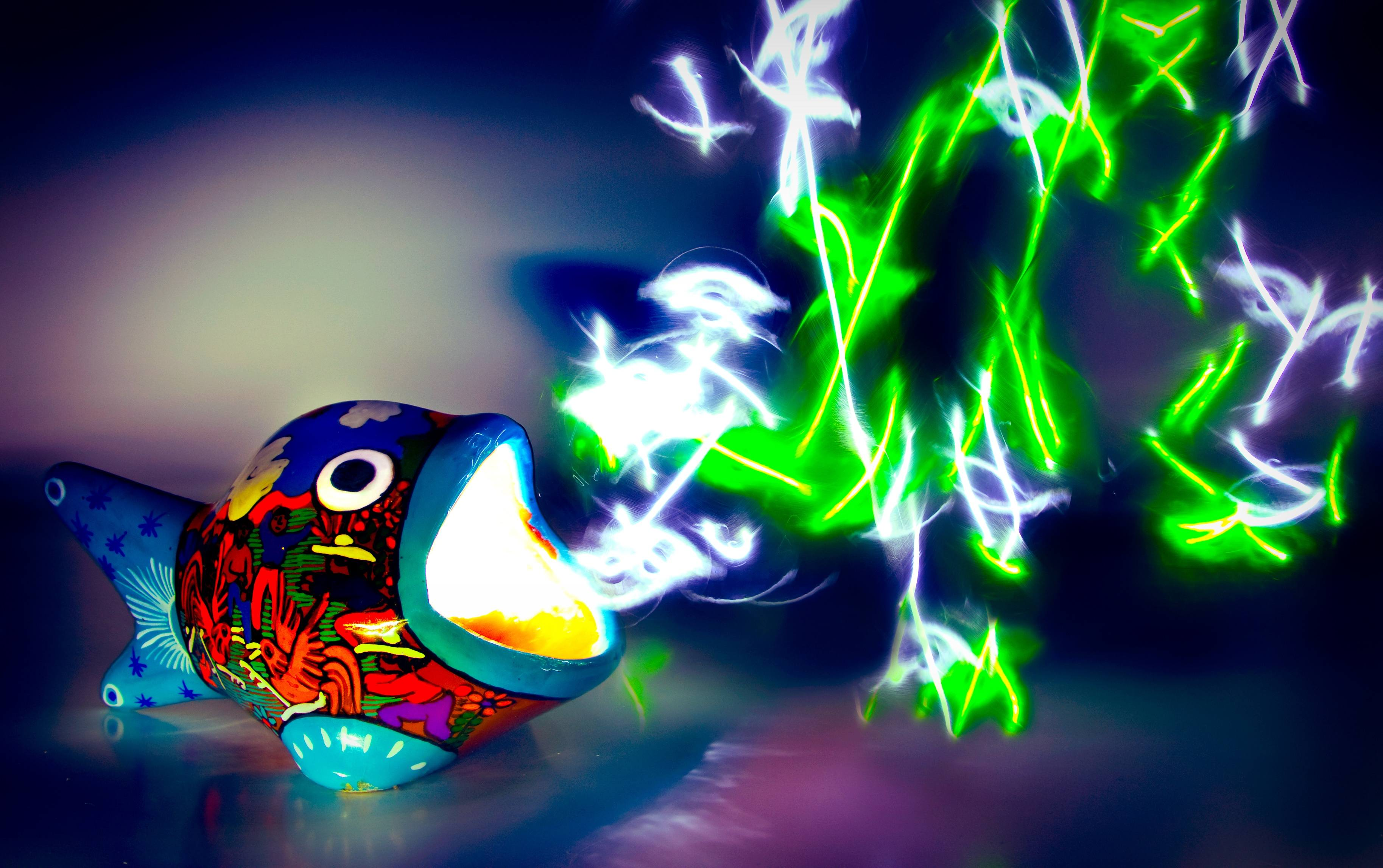 A light painted image of a hand-painted ceramic fish with light emitting from its mouth<div class='credit'><strong>Credit:</strong> A light painted image of a hand-painted ceramic fish with light emitting from its mouth</div>