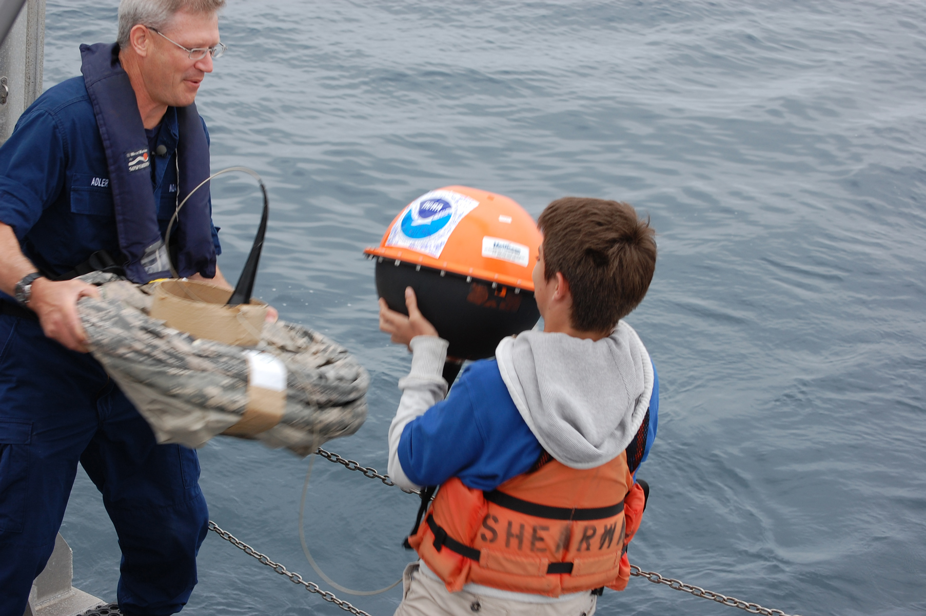 A student helps deploy one of his school's adopted drifters for NOAA's Adopt a Drifter Program. <div class='credit'><strong>Credit:</strong> A student helps deploy one of his school's adopted drifters for NOAA's Adopt a Drifter Program. </div>