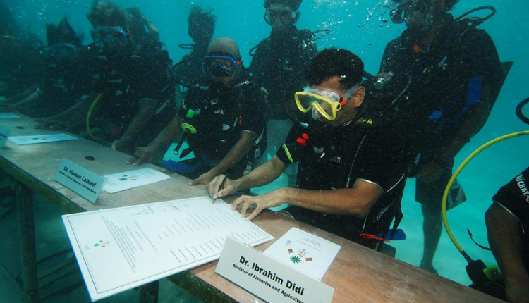 Cabinet ministers from the Maldives sign a declaration to fight climate change – underwater!<div class='credit'><strong>Credit:</strong> Cabinet ministers from the Maldives sign a declaration to fight climate change – underwater!</div>