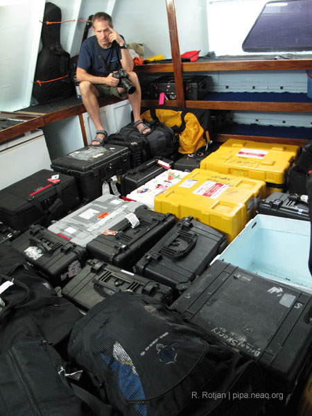 Brian Skerry in a room with all his photography equipment cases.<div class='credit'><strong>Credit:</strong> Brian Skerry in a room with all his photography equipment cases.</div>