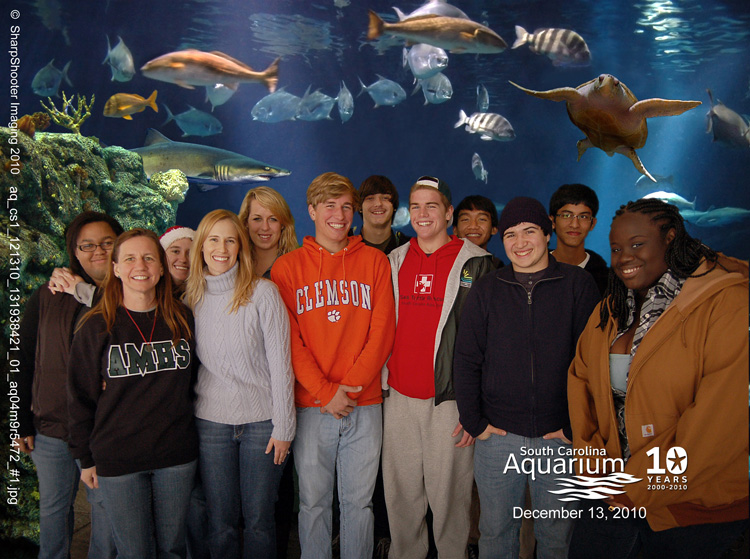 Students pose in front of an aquarium tank with fish.<div class='credit'><strong>Credit:</strong> Students pose in front of an aquarium tank with fish.</div>