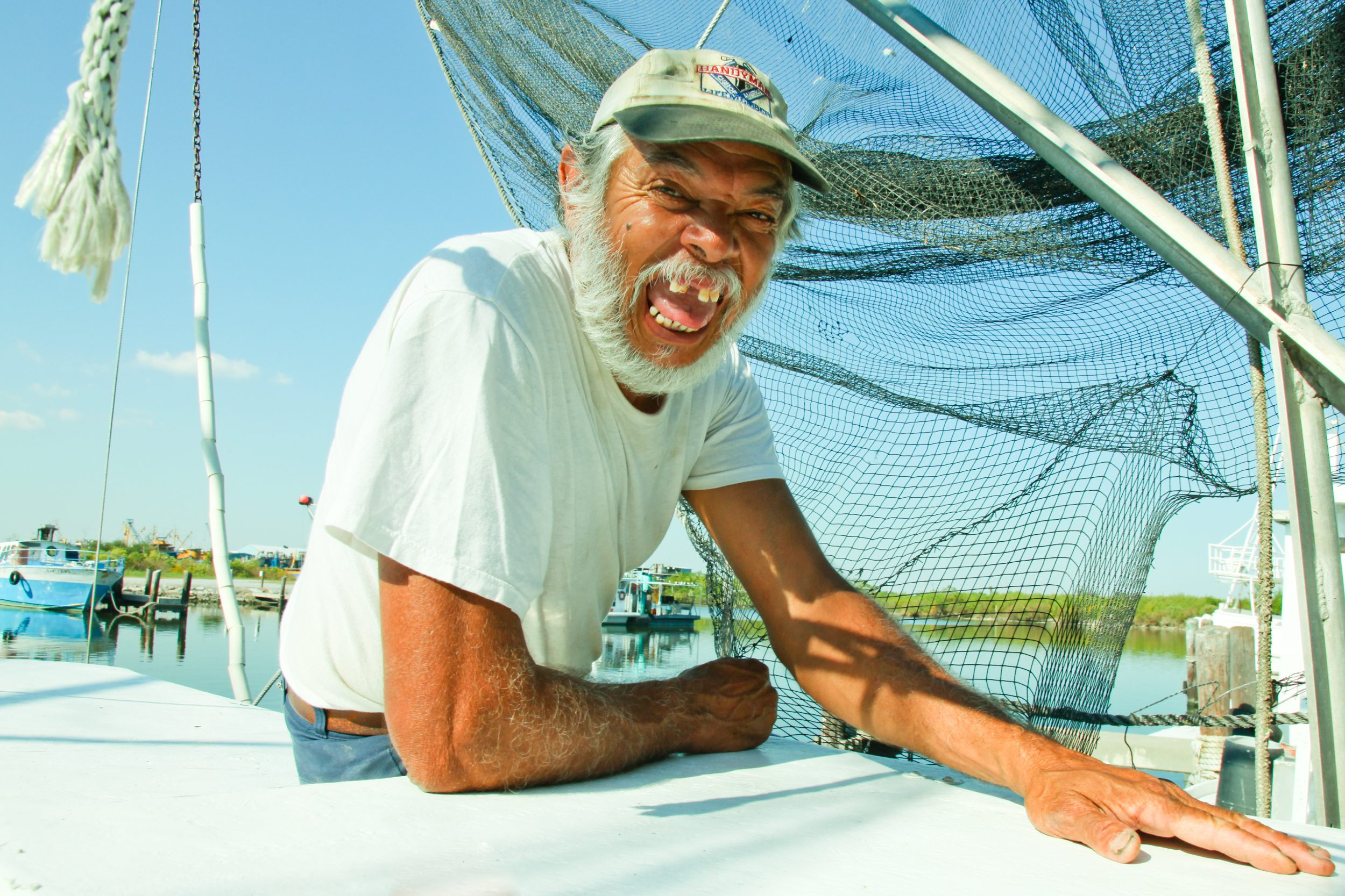 A Gulf Coast resident sits on his boat, smiling for the camera. <div class='credit'><strong>Credit:</strong> A Gulf Coast resident sits on his boat, smiling for the camera. </div>