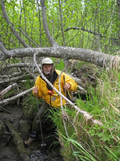 Botanist Dennis Whigham stands in a forested wetland with field gear. <div class='credit'><strong>Credit:</strong> Botanist Dennis Whigham stands in a forested wetland with field gear. </div>