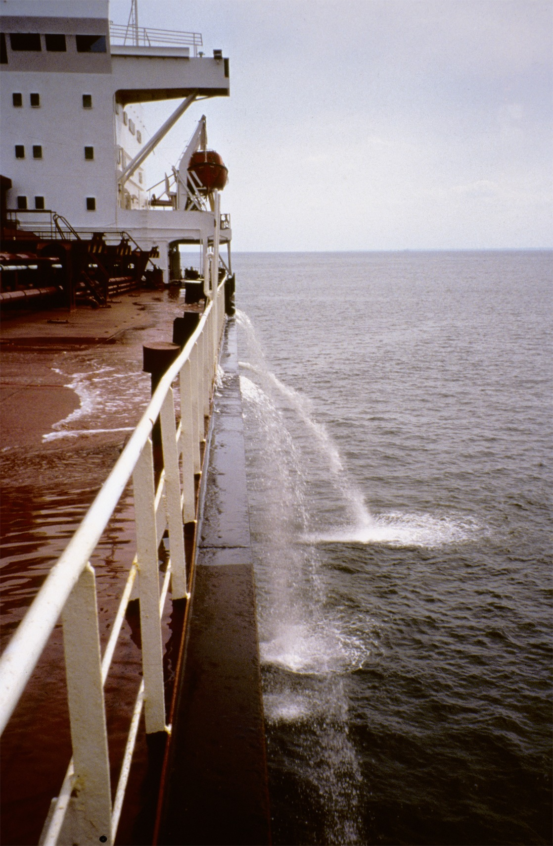A large ship flushes water from its ballast tanks while at sea<div class='credit'><strong>Credit:</strong> A large ship flushes water from its ballast tanks while at sea</div>
