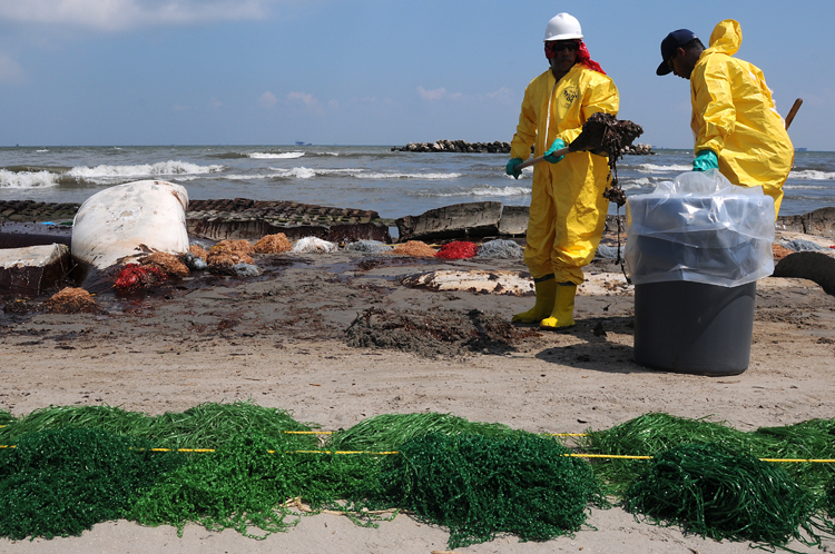 Health, Safety, and Environment (HSE) workers contracted by BP clean up oil on the beach in Port Fourchon, La. May 23, 2010.<div class='credit'><strong>Credit:</strong> Health, Safety, and Environment (HSE) workers contracted by BP clean up oil on the beach in Port Fourchon, La. May 23, 2010.</div>