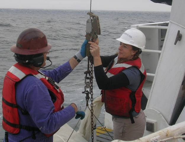 Research Zoologist, Karen Osborn on a ship at sea, working to release a line<div class='credit'><strong>Credit:</strong> Research Zoologist, Karen Osborn on a ship at sea, working to release a line</div>