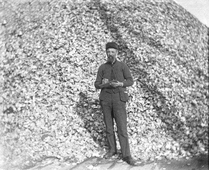 A longshoreman standing in front of a large pile of oyster shells on waterfront pier in Atlantic City in 1910.<div class='credit'><strong>Credit:</strong> A longshoreman standing in front of a large pile of oyster shells on waterfront pier in Atlantic City in 1910.</div>
