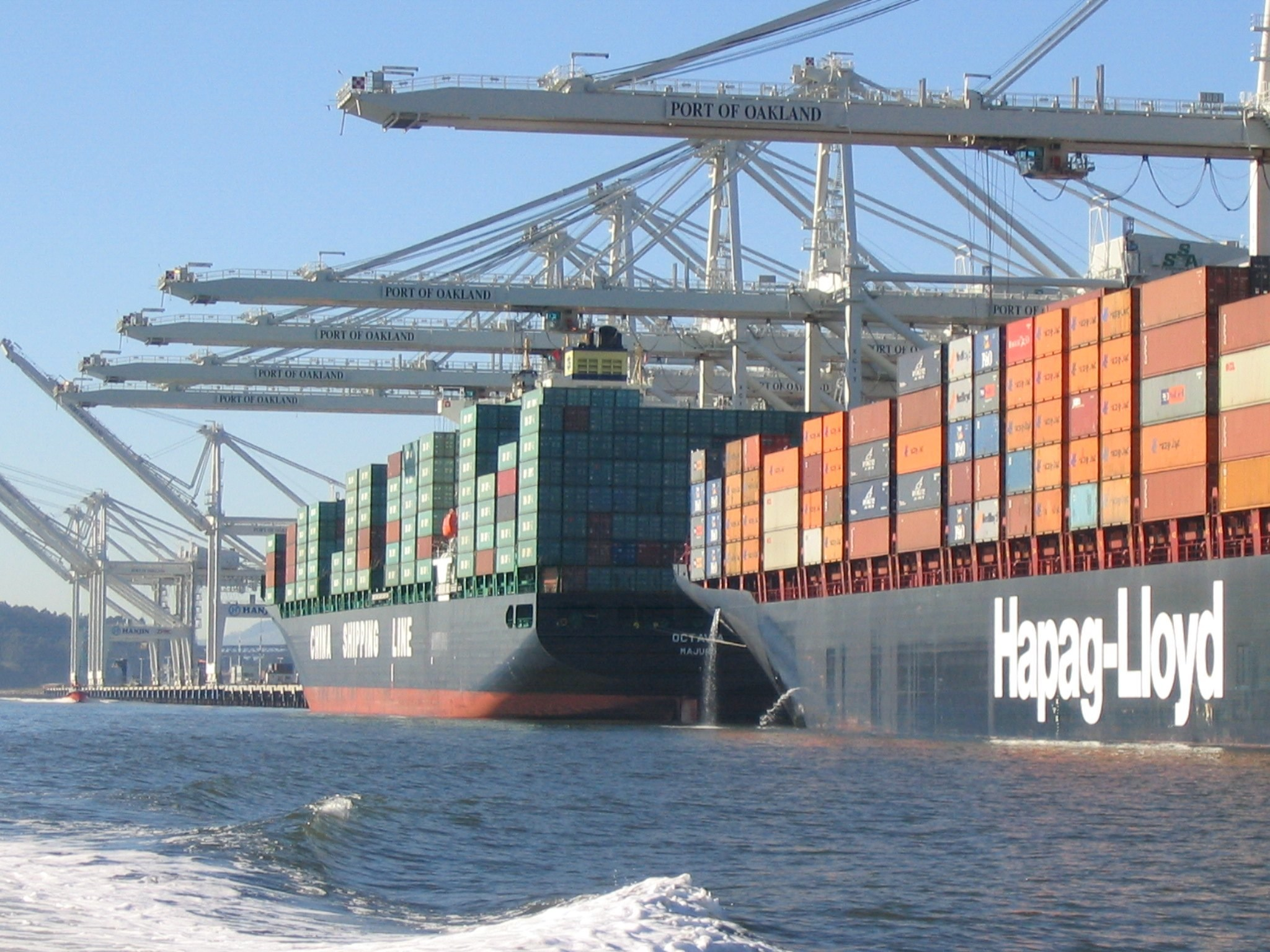 Large container ships at port, discharging ballast water in the Port of Oakland<div class='credit'><strong>Credit:</strong> Large container ships at port, discharging ballast water in the Port of Oakland</div>