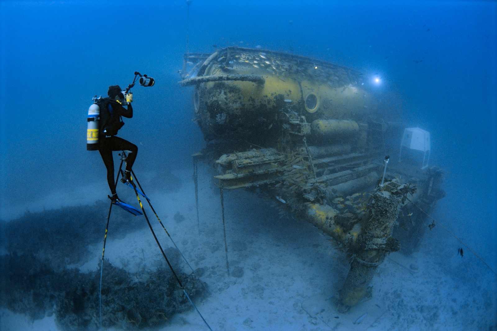 Brian Skerry sits on a 20 foot high underwater tripod to photograph the Aquarius Habitat off Florida.<div class='credit'><strong>Credit:</strong> Brian Skerry sits on a 20 foot high underwater tripod to photograph the Aquarius Habitat off Florida.</div>