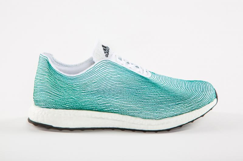 A turquoise and white adidas sneaker made of recycled ocean plastic.