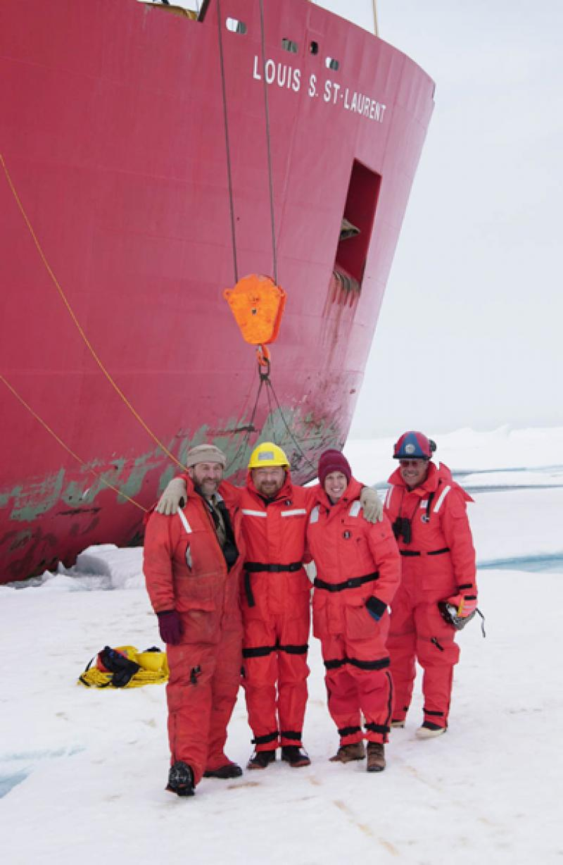 Dr. Kathy Crane and colleagues stand on solid sea ice in the Canadian Arctic.