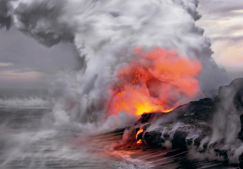 """In the upper left of this image I can visualize the profile of Pele, the fire goddess of Hawaiian folklore, as if she is whispering to the sea."" -- Nature's Best photographer, Peter Lik.Equipment Used to Capture the Shot: Canon EOS-1Ds Mark III; 5"