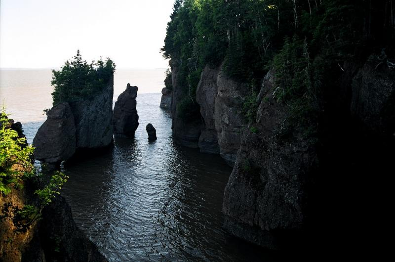 The Bay of Fundy in Nova Scotia, Canada has the highest tidal range. The tides range from 3.5m (11ft) to 16m (53ft) and cause erosion to the landscape, creating massive cliffs.
