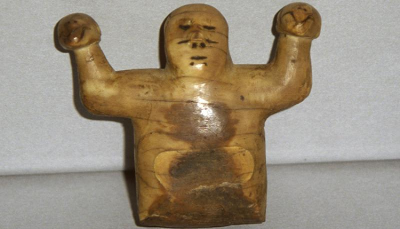 This ivory sculpture from Point Barrow, Alaska, represents Kikámigo, a guardian spirit, holding a whale in each hand.