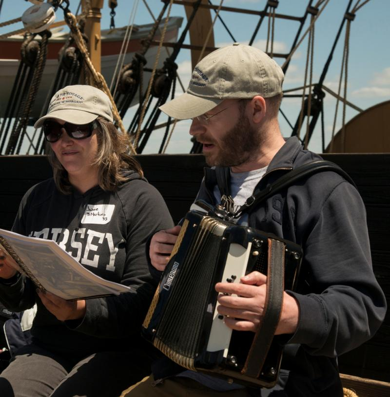 Two of the 38th Voyagers sing on board the Charles W. Morgan as it travels to ports throughout New England.