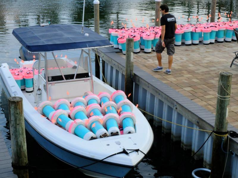 A boat full of SCOPE drifters waits to release small, biodegradable buoys that will travel throughout the Gulf of Mexico and send GPS coordinates to researchers.