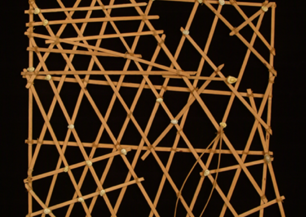 A square of interwoven sticks and cowrie shells