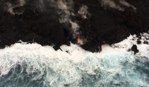 An aerial view of the Hawaii's shore with lava flowing into the ocean from Kilauea volcano.