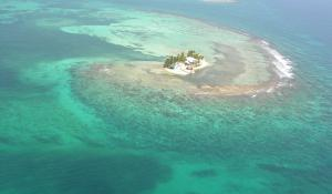 Carrie Bow Cay field station sits in the blue and turquoise waters of Belize.
