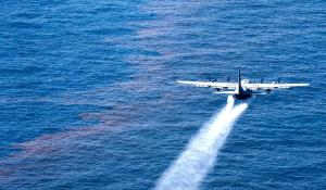 A C-130 Hercules from the Air Force Reserve Command deploys dispersant into the Gulf of Mexico May 5, 2010, as part of the Deepwater Horizon/BP oil spill response effort.