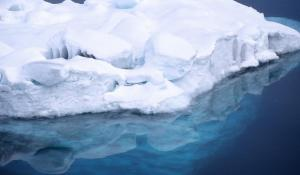 Looking through this iceberg's reflection in the Antarctic water, you can see the iceberg below the surface—some 90% of its total volume.