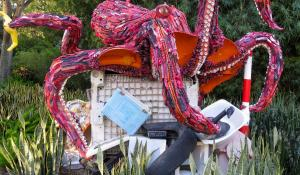 A sculpture of a giant octopus made of ocean debris