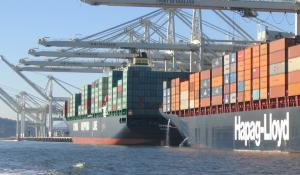 Large container ships at port, discharging ballast water in the Port of Oakland