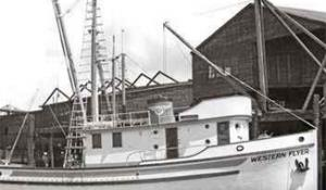 Black and white image of the Western Flyer boat at dock.