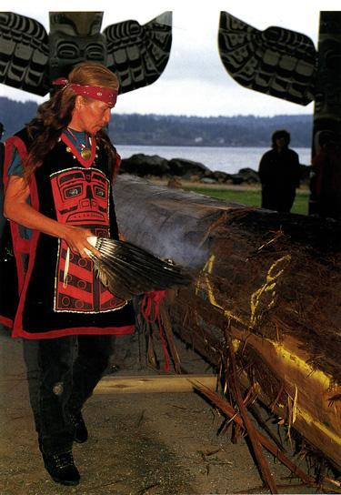 Elders bless a new canoe with lighted sage, song, and traditional dances.