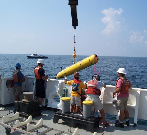 An autonomous underwater vehicle from the Monterey Bay Aquarium Research Institute (MBARI) being launched from the NOAA Ship Gordon Gunter in the Gulf of Mexico.