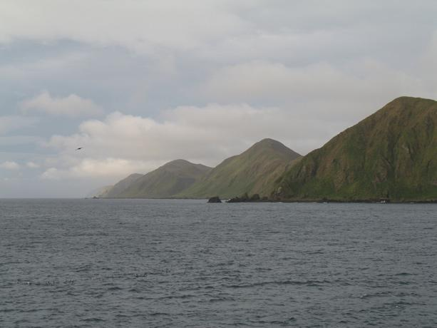 The Macquarie Island site in Australia was inscribed on the World  Heritage List in 1997. The island is the exposed crest of the undersea  Macquarie oceanic ridge, raised to its present position where the  Indo-Australian tectonic plate meets the Pacific p