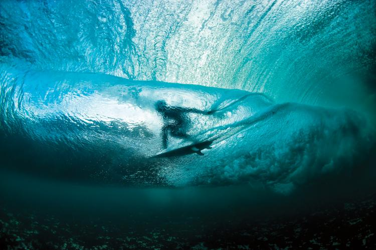 """This photograph I call 'Emerald Spirit' was taken on the most intimidating and most surf-heavy spot on the western coast of Ireland. Local surfer Fergal Smith was paddling and scoring a few deep tube rides inside the waves. Each time he started to p"