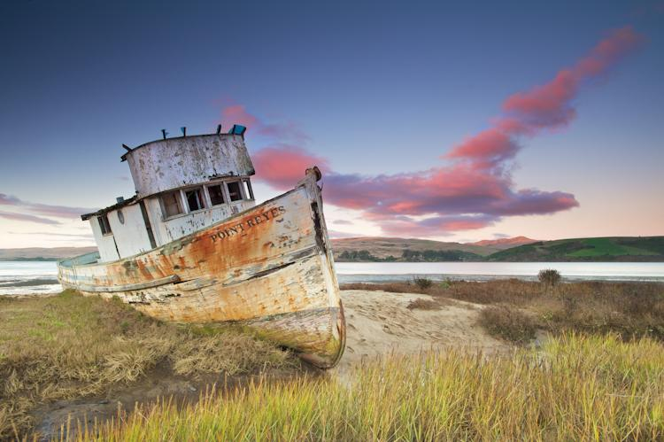 """Tomales Bay is a narrow, protected waterway along the San Andreas fault. In years past, it was known for its thriving fishing industry. This boat is a relic from better times for local fishermen, and few of its kind can still be found today. The ridgeli"