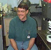 Michael Vecchione sitting in a lab.