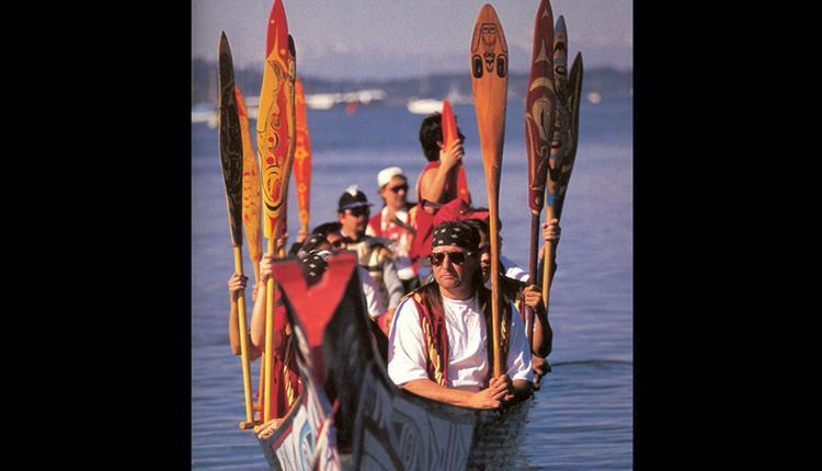Members of the Squamish Nation paddle to a 1997 festival celebrating Native canoe arts.