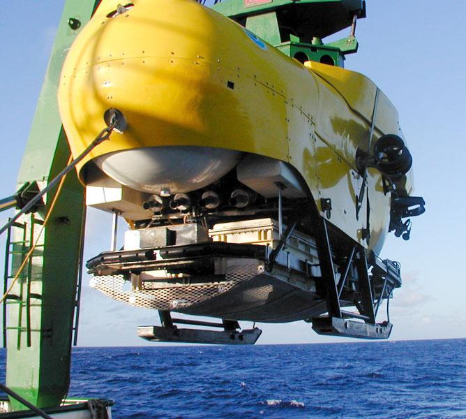 The Hawaii Undersea Research Laboratory's Pisces V submersible is lowered for a dive to study deep-sea corals.