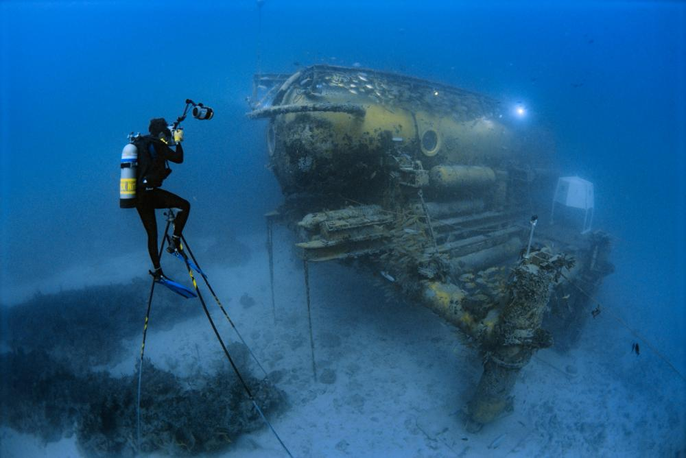 Brian Skerry sits on a 20 foot high underwater tripod to photograph the Aquarius Habitat off Florida.