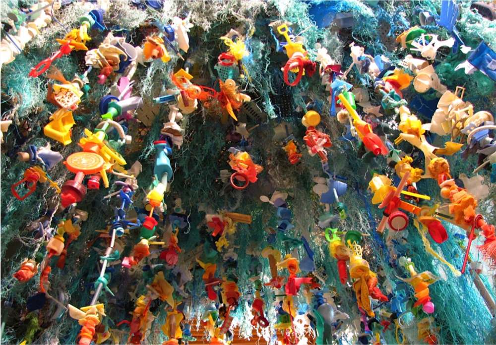 The Gyre is an abstract piece symbolizing the Great Pacific Garbage Patch, a large ocean vortex that collects trash from around the Pacific Ocean.