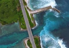 An aerial view of a roadway on an island